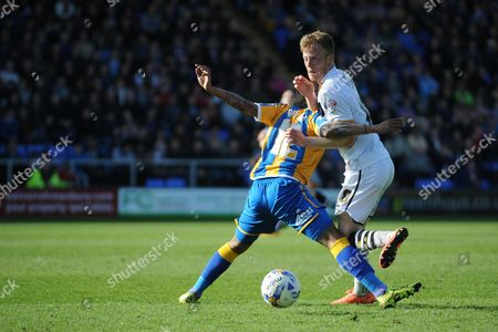 Sam Kelly of Port Vale FC finds his path blocked by Junior Brown of Shrewsbury Town during the Sky Bet League 1 match between Shrewsbury Town and Port Vale at Greenhous Meadow, Shrewsbury