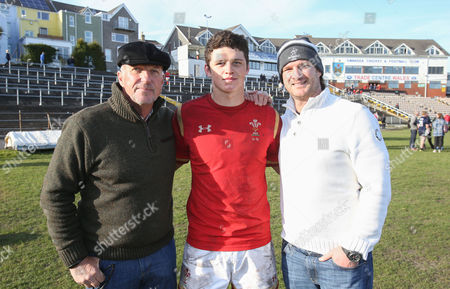 Jim Botham of Wales with his father Liam Botham and grandfather Sir Ian Botham after he made his debut for Wales U18s against Scotland