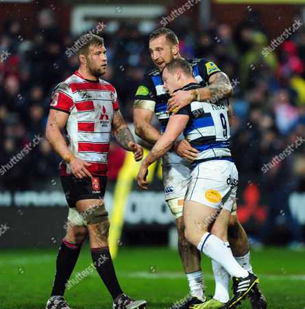 Chris Cook of Bath Rugby is congratulated on his try by team-mate Dominic Day
