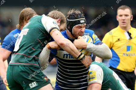 Andrei Ostrikov is tackled by Tom Croft  and Graham Kitchener during the Aviva Premiership match between Sale Sharks v Leicester Tigers played at The A J Bell Stadium, Salford on March 27th, 2016