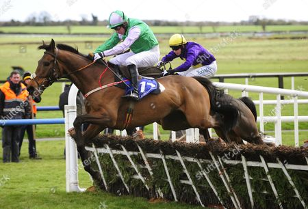 Fairyhouse THREE WISE MEN & Noel Fehily jump the last to win the Cusacks Hotel Maiden Hurdle from CROWN OF GOLD & Jim Culloty.