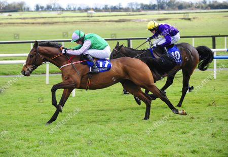 Stock Picture of Fairyhouse THREE WISE MEN & Noel Fehily jump the last to win the Cusacks Hotel Maiden Hurdle from CROWN OF GOLD & Jim Culloty.