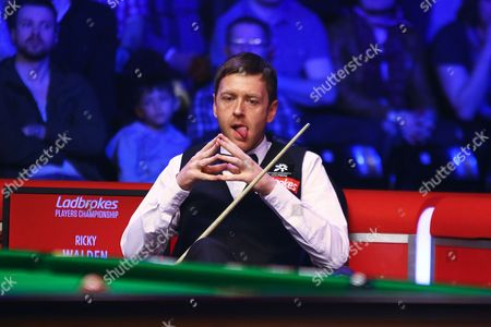 Ricky Walden sits ready for his next shot during the Snooker Players Championship Final at EventCity, Manchester