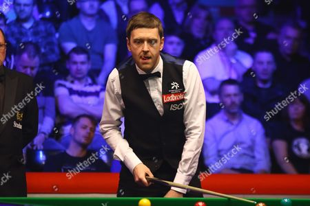 Ricky Walden eyes up a shot during the Snooker Players Championship Final at EventCity, Manchester