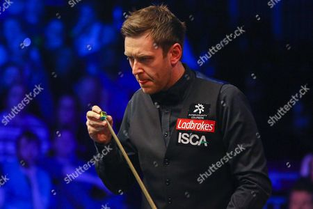 Ricky Walden chalking his cue during the Snooker Players Championship Final at EventCity, Manchester