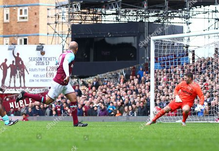 Paolo Di Canio of West Ham United All-Stars scores his goal   during the Mark Noble Testimonial  match between West Ham United and West Ham United All Stars    played at Boleyn Ground , London on 28th March 2015