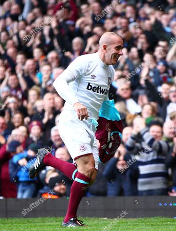 Paolo Di Canio of West Ham United All-Stars celebrates scoring  his goal     during the Mark Noble Testimonial  match between West Ham United and West Ham United All Stars    played at Boleyn Ground , London on 28th March 2015