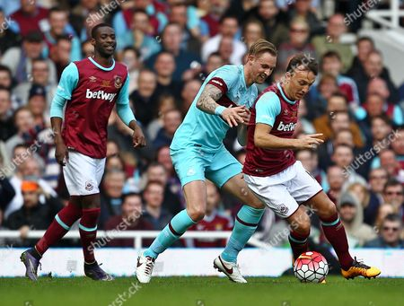 Mark Noble of West Ham United and Jack Collison   of West Ham United All-Stars  during the Mark Noble Testimonial  match between West Ham United and West Ham United All Stars    played at Boleyn Ground , London on 28th March 2015