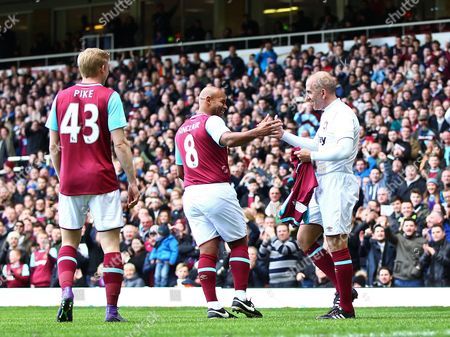 Paolo Di Canio of West Ham United All-Stars is congratulated by Trevor Sinclair of West Ham United All-Stars after scoring his goal  during the Mark Noble Testimonial  match between West Ham United and West Ham United All Stars    played at Boleyn Ground , London on 28th March 2015