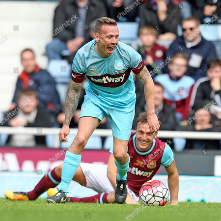 Craig Bellamy gets away from the laughing Mark Noble.