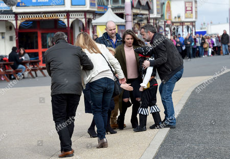 Michael LeVell (Kevin), Brooke Vincent (Sophie) check Kyran Bowes (Jack)