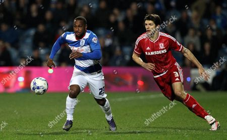 David Hoilett of Queens Park Rangers goes past George Friend of Middlesbrough