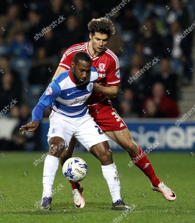 David Hoilett of Queens Park Rangers is challenged by George Friend of Middlesbrough