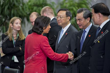 Susan Rice, United States national security advisor, left, greets Wang Yi, China's foreign minister, as she arrives to a P5+1 multilateral meeting