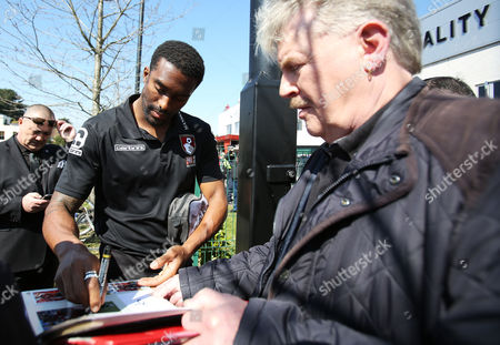 Sylvain Distin of Bournemouth signs autographs before the Barclays Premier League match between AFC Bournemouth and Manchester City played at The Vitality Stadium, Bournemouth on April 2nd 2016