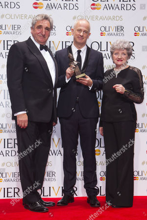 Dominic Cooke accepts the award for Best Revival, presented by Jiim Carter and Julia McKenzie, for Ma Rainey's Black Bottom at the National