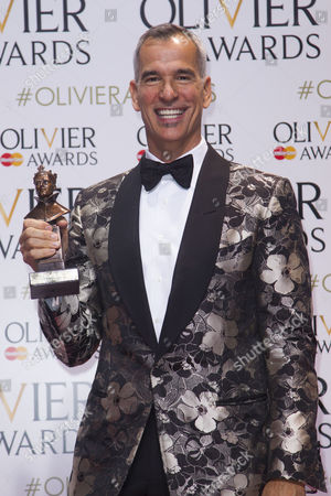 Stock Picture of Jerry Mitchell accepts the award for Best Costume Design, on behalf of Gregg Barnes, for Kinky Boots at the Adelphi