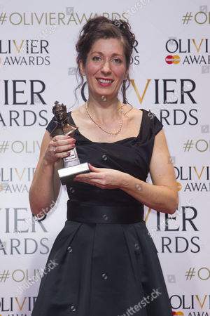 Anna Fleischle accepts the award for Best Set Design for Hangmen at the Royal Court and Wyndham's