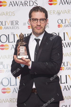 Robert Icke accepts the award for Best Director for Oresteia at the Almeida