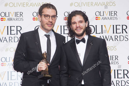 Robert Icke accepts the award for Best Director, presented by Kit Harington, for Oresteia at the Almeida