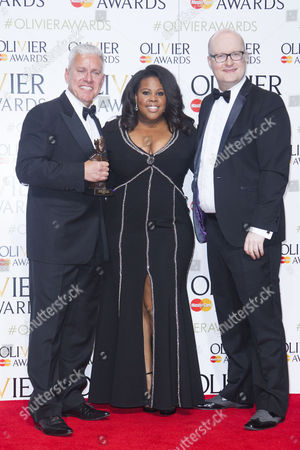 David Ian and Michael Harison accept the award for Best Musical Revival, presented by Amber Riley, for Gypsy at the Savoy