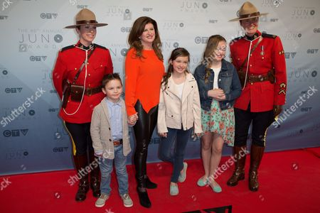 Stock Picture of Rona Ambrose with children and Canadian Mounties