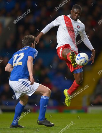 Jonathan Douglas of Ipswich Town watches as Yaya Sanogo of Charlton Athletic controls the ball during the Sky Bet Championship match between Ipswich Town and Charlton Athletic played at Portman Road, Ipswich on April 5th 2016