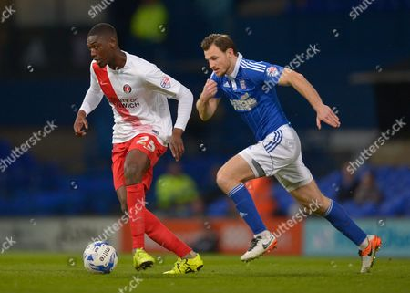 Yaya Sanogo of Charlton Athletic and Tommy Smith of Ipswich Town during the Sky Bet Championship match between Ipswich Town and Charlton Athletic played at Portman Road, Ipswich on April 5th 2016