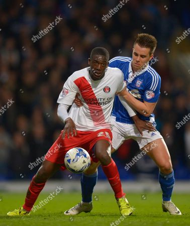 Yaya Sanogo of Charlton Athletic and Jonas Knudsen of Ipswich Town during the Sky Bet Championship match between Ipswich Town and Charlton Athletic played at Portman Road, Ipswich on April 5th 2016