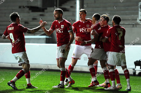 Peter Odemwingie of Bristol City celebrates with his team mates after scoring
