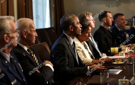 United States President Barack Obama (3L) meets with Combatant Commanders and Joint Chiefs of Staff with Vice President Joe Biden (2L) and US National Security Advisor Susan Rice (4L) in the Cabinet Room