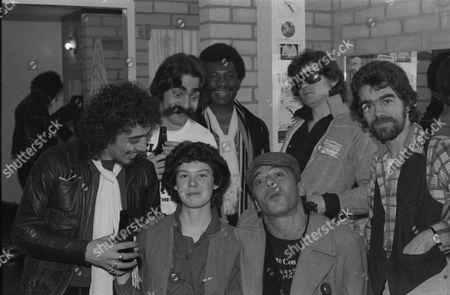 Stock Picture of Ian Dury & the Blockheads at Loughborough University.  Front row: Norman Watt-Roy, Sue Robertson, Ian Dury, John Turnbull. Back row: John 'Irish' Earle, Charley Charles, Mickey Gallagher