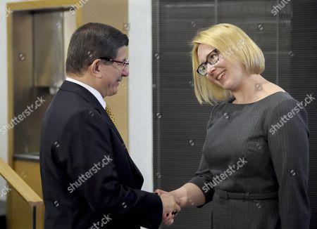Turkish Prime Minister Ahmet Davutoglu met with Speaker of the Finnish Parliament Maria Lohela (R) in Helsinki