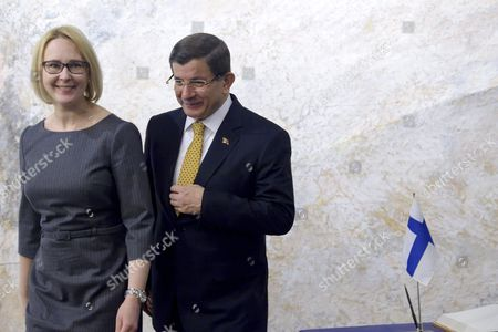 Turkish Prime Minister Ahmet Davutoglu (R) met with Speaker of the Finnish Parliament Maria Lohela in Helsinki