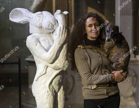 Artist Sophie Ryder poses with her dog Pedro next to the 6ft marble figure called Mother and child. A mother lady-hare loving and protectively cradles her baby dog.