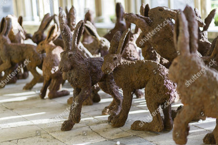 Temple to the Two Hundred Rabbits - a fibreglass with iron filing of a colony of rabbits living and playing together in harmony by artist Sophie Ryder.