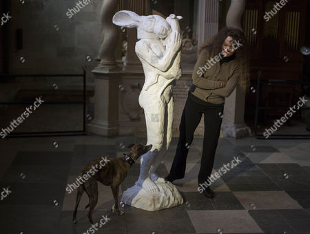 Artist Sophie Ryder poses with the 6ft marble figure called Mother and child. A mother lady-hare loving and protectively cradles her baby dog.