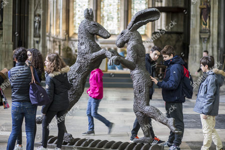 Pink Lady Dancing with Brown Dog- a bronze by the artist Sophie Ryder.