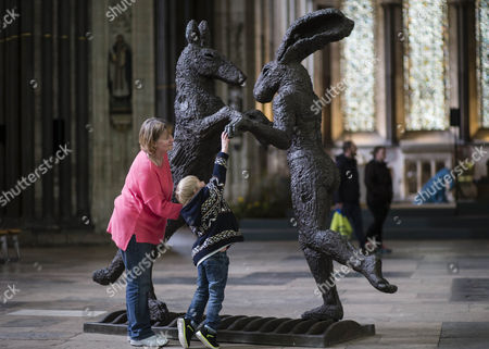 Janice Crisp explores the bronze -Pink Lady Dancing with Brown Dog with her grandson Hayden aged 6.
