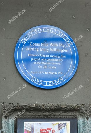 Stock Photo of A blue plaque commemorating Britain's longest running film, 'Come Play With Me' starring Mary Millington, which played continuously at the Moulin Cinema for 201 weeks from 1977 to 1981.