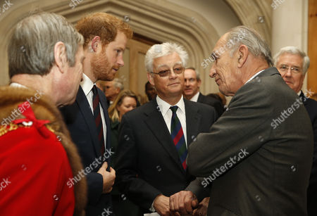 Prince Harry, second left, talks to General Michael David Jackson, right, at the Lord Mayor's Big Curry Lunch in aid of the ABF The Soldiers Charity