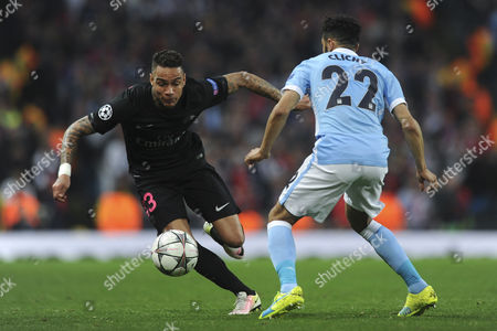 Gregory van der Wiel of Paris Saint-Germain looks to get past Gael Clichy of Manchester City during Manchester City vs Paris St Germain, UEFA Champions League Football at the Etihad Stadium on 12th April 2016