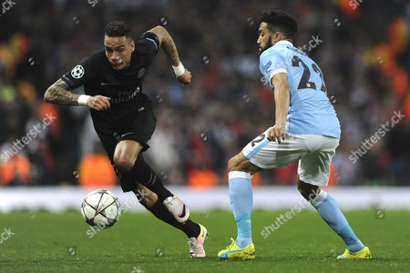 Gregory van der Wiel of Paris Saint-Germain gets past Gael Clichy of Manchester City during Manchester City vs Paris St Germain, UEFA Champions League Football at the Etihad Stadium on 12th April 2016