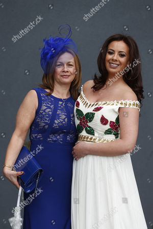 Michelle Ryan, left, and Kelly Worthington pose for photographs during Ladies Day, Day Two of the Crabbies Grand National festival at Aintree Racecourse, Liverpool on the 7th April 2016