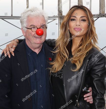 Kevin Cahill (CEO; Comic Relief) and Nicole Scherzinger