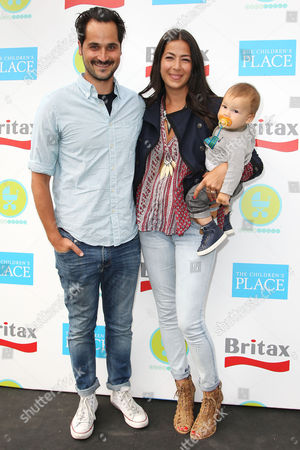 Stock Image of Gavin Bellour and Rebecca Minkoff with son Luca Shai