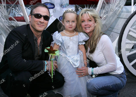 Stock Image of Clint Black and Lisa Hartman with daughter Lily Pearl Black