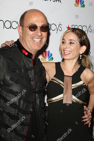 Stock Picture of John Varvatos and Luciana Scarabello