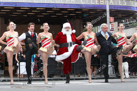 Radio City Rockettes with Race Taylor (WPLJ), Santa Claus, and James Covington (Capital One Bank Manhattan market President)