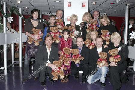 Back Row - Honey Kalaria (2nd L), John Bowe, Judy Finnigan, Joanna Lumley and Jennifer Saunders. Front Row - Richard Madeley, Eric Knowles (c) and Melanie Kilburn (1st R)
